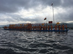Hundreds of leg-rowers propel the boats through the water in a continuous flotilla