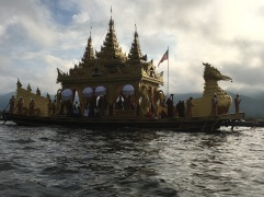 At the end of the procession is the final barge which contains four buddha idols from the main monastery on the lake
