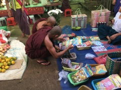 Monks at the local market deciding what they want to watch tonight.