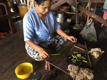 Extracting the thread from lotus plants.